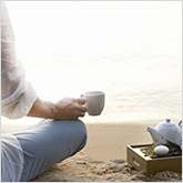 Person Drinking Tea on the Beach