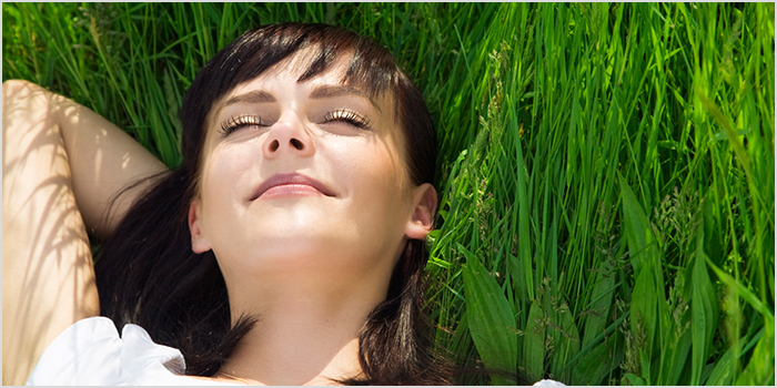 Woman Laying in the Grass, Smiling