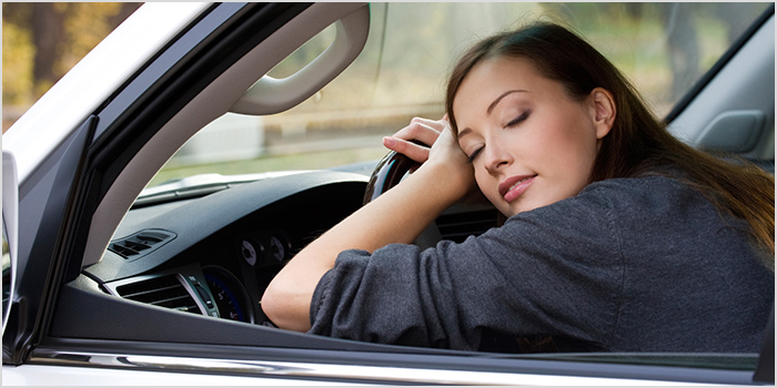 Woman Laying on Steering Wheel
